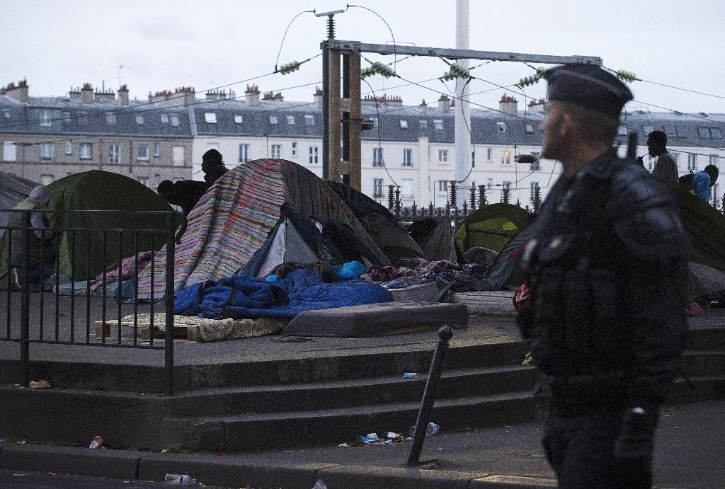 French police clear migrant camps in Paris, Calais