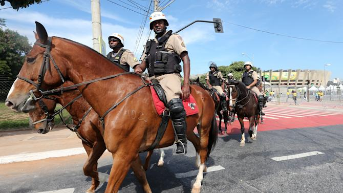 Mounted police officers patrol outside the Mineirao stadium prior to one of the semifinals of the Confederations Cup between Brazil and Uruguay in Belo Horizonte, Brazil, Wednesday, June 26, 2013. (AP Photo/Andre Penner)