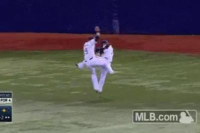 MLB players collide on outfield catch, high five to celebrate