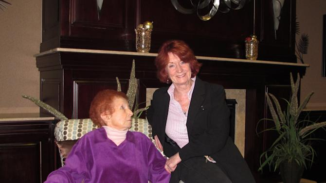 In this Dec. 17, 2012 photo, Marion Johnston, left, and her daughter Linda Monaco, sit in a lounge at the Bristal Assisted Living facility in Massapequa, N.Y. Johnston is among a number of elderly residents whose homes were damaged by Superstorm Sandy who opted to move to assisted living facilities rather than remain living on their own. (AP Photo/Frank Eltman)