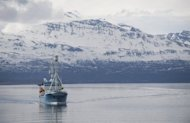 The University of Tromso&#39;s research vessel Lance sails near a fjord off Troms, Norway. US Secretary of State Hillary Clinton took a first hand look at the way a warming climate is changing the Arctic, opening a once frozen region to competition for vast oil reserves