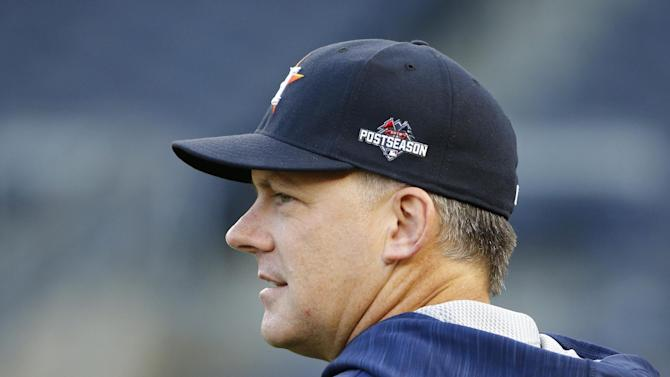 Houston Astros manager A.J. Hinch looks to the outfield during a workout at Yankee Stadium in New York, Monday, Oct. 5, 2015, for an American League Wild Card baseball game against the New York Yankees on Tuesday. (AP Photo/Kathy Willens)
