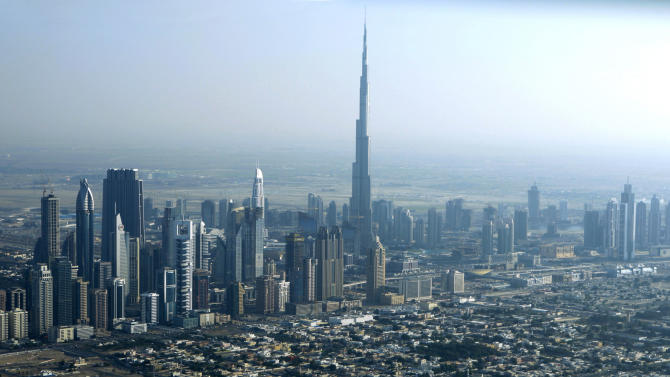 FILE - In this Sunday, Jan. 3, 2010 file photo, Burj Dubai, the world's tallest building, seen at center, in Dubai, United Arab Emirates. It suddenly seems like Dubai is rediscovering its old habits. That means breathless hype is now back in vogue. Construction plans are again peppered with superlatives. (AP Photo/Kamran Jebreili, file)
