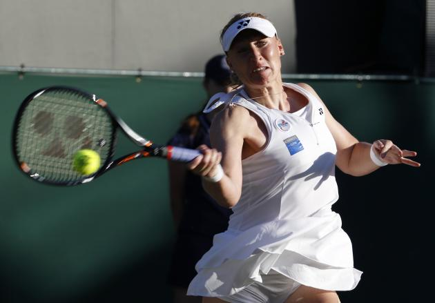 File photograph shows Elena Baltacha of Britain hitting a return to Petra Kvitova of the Czech Republic during their women's singles tennis match at the Wimbledon tennis championships in London