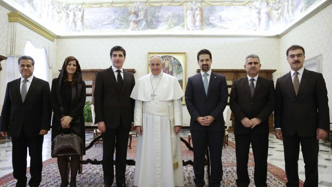 Pope Francis poses with Iraq's Kurdistan Prime Minister Barzani's, his wife Nabila and members of the delegation during a private audience at the Vatican