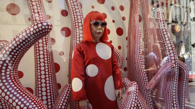 A wax model of Japanese artist Yayoi Kusama is displayed in the windows of Louis Vuitton's flagship Fifth Avenue store in New York, Tuesday, July 10, 2012, part of a collaborative collection by Kusama and Vuitton creative director Marc Jacobs, shown after they were unveiled Tuesday.  (AP Photo/Kathy Willens)