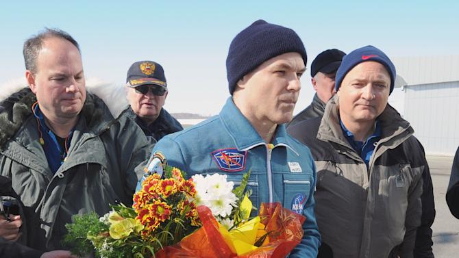 NASA's astronaut Kevin Ford arrives back to the earth with Russian cosmonauts Oleg Novitsky and Yevgeny Tarelkin, not in the photo, in a Soyuz space capsule, at an airport of Kazakh city of Kostanai, Saturday, March 16, 2013. The Soyuz space capsule carrying the three men landed Saturday morning on the steppes of Kazakhstan after 144 days aboard the International Space Station, ISS. (AP Photo/Alexander Nemenov, Pool)