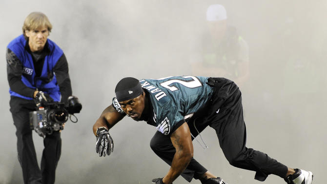 Former Philadelphia Eagles safety Brian Dawkins is introduced onto the field before an NFL football game between the Eagles and the New York Giants, Sunday, Sept. 30, 2012, in Philadelphia. The Eagles retired his No. 20 jersey during a pre-game ceremony. (AP Photo/Michael Perez)