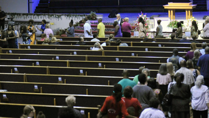 Mourners file past the casket of 8-year-old Cherish Perrywinkle during a viewing at Paxon Revival Center Church on Thursday, June 27, 2013 in Jacksonville, Fla. Cherish, who police say was targeted by a registered sex offender, was abducted and killed last Friday. (AP Photo/The Florida Times-Union, Will Dickey)