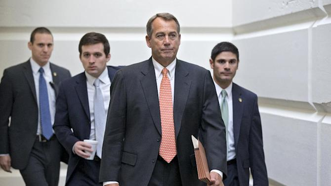"""House Speaker John Boehner of Ohio, who conferred with President Barack Obama yesterday by phone, walks to a closed-door meeting with the GOP caucus, Wednesday, Dec. 12, 2012, on Capitol Hill in Washington. Boehner and the other House Republican leaders are calling for Obama to come up with plan they can accept for spending cuts and tax revenue to avoid the so-called """"fiscal cliff"""" of automatic tax hikes and budget reductions. (AP Photo/J. Scott Applewhite)"""
