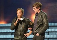 Dan Auerbach (L) and Patrick Carney from The Black Keys receive their Grammy for Best Rock Performance at the Staples Center during the 55th Grammy Awards in Los Angeles, California, on February 10, 2013