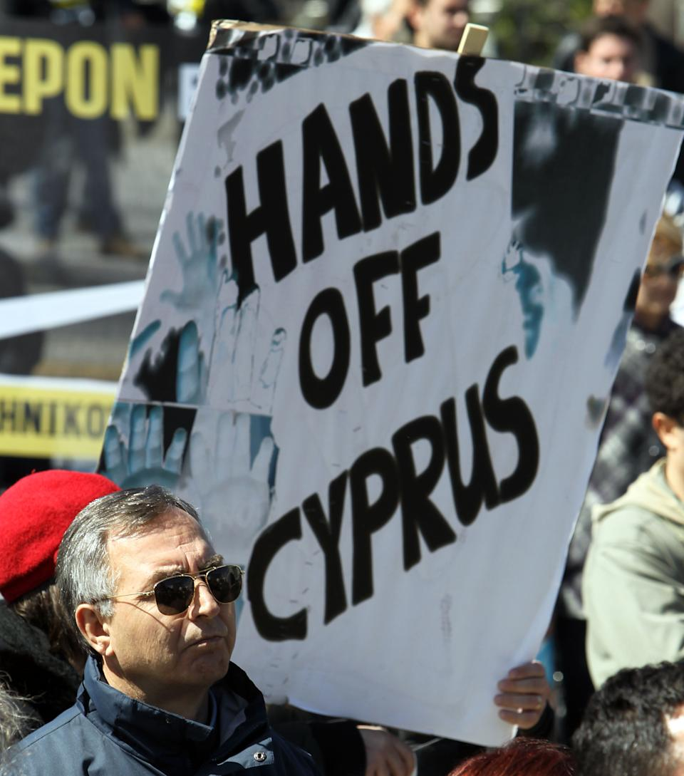 Cyprus lawmakers approve key bills for bailout