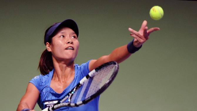 Li Na of China prepares to serve to Angelique Kerber of Germany during their tennis match on the third day of the WTA championship in Istanbul, Turkey, Thursday, Oct. 25, 2012. (AP Photo)