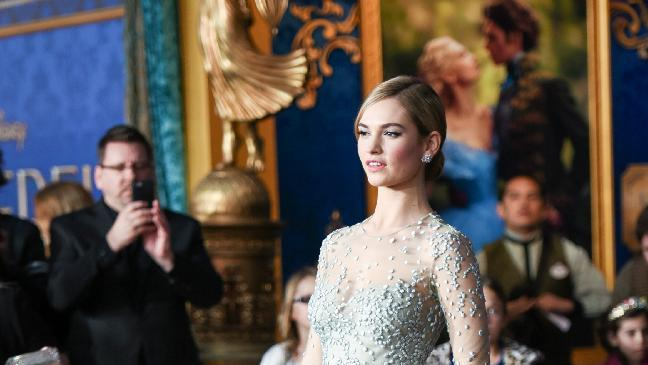"Lily James arrives at the Premiere Of ""Cinderella"" on Sunday, March 1, 2015, in Los Angeles. (Photo by Richard Shotwell/Invision/AP)"