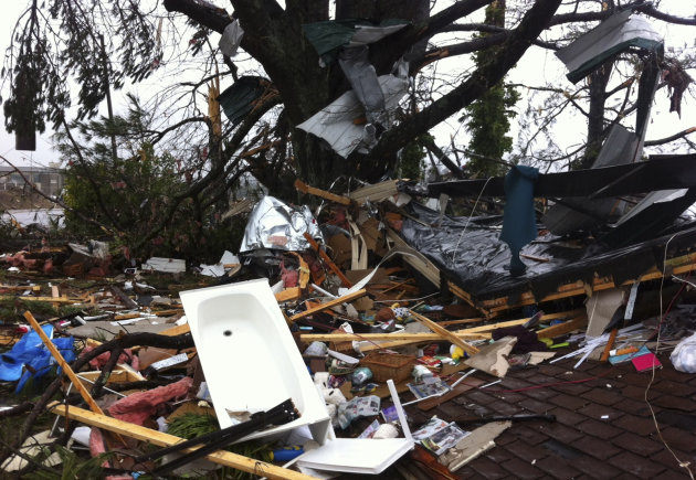 Debris lies on yard after a tornado moved through  Adairsville, Ga. Wednesday, Jan. 30, 2013. A fierce storm system that roared across northwest Georgia has left at least one person dead and a trail o