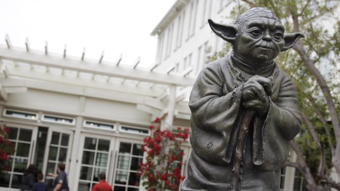 FILE - In this Aug. 2, 2011 photo, a life-sized replica of Yoda, George Lucas' master of the Force, is shown at Lucasfilm Ltd. production studios in San Francisco.  Lucas is moving forward with plans to build a park complete with a statue of Yoda and Indiana Jones in his Marin County hometown of San Anselmo, Calif. Lucas has applied for a permit to demolish the existing buildings at the site. (AP Photo/Paul Sakuma, File)