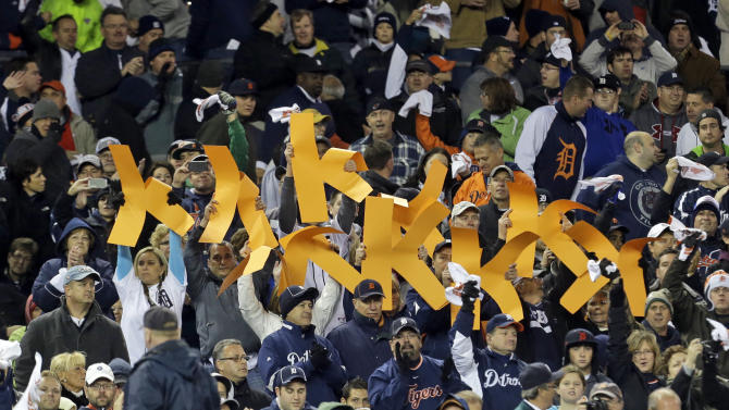 Detroit Tigers fans hold up strikeout K's for starting pitcher Justin Verlander during the fifth inning of Game 1 of the American League division baseball series against the Oakland Athletics, Saturday, Oct. 6, 2012, in Detroit. (AP Photo/Paul Sancya)