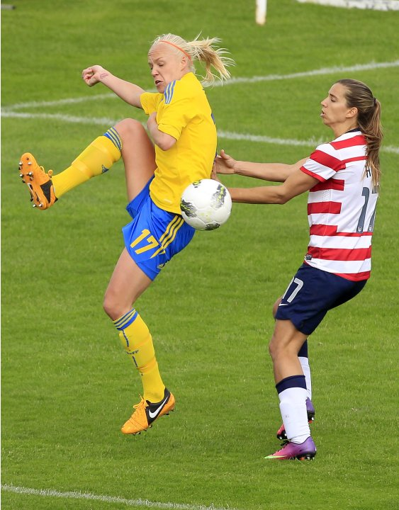 Sweden's Caroline Seger challenges for a ball with Tobin Heath of the U.S. during their women's Algarve Cup soccer match at the Lagos city stadium in southern