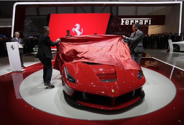 The new LaFerrari hybrid car is uncovered on the Ferrari stand during the first media day of the 83rd Geneva Car Show at the Palexpo Arena in Geneva