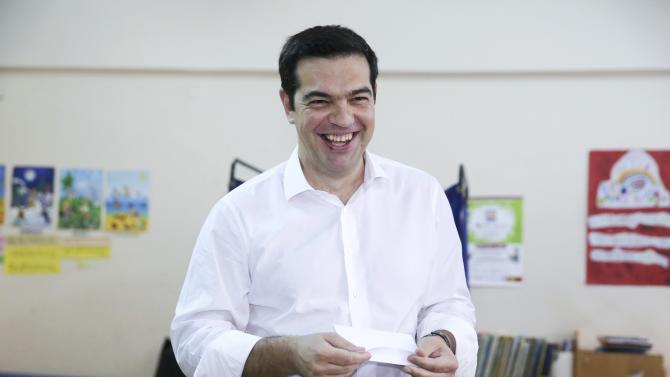 Greek Prime Minister Alexis Tsipras arrives to cast his ballot at a polling station in Athens