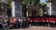 Guardsmen march past onlookers into Buckingham Palace during the Changing of the Guard in London in July 2012. The decision to publish photos of Prince William&#39;s wife Catherine topless has incensed the royal family, whose lawyers have obtained a civil injunction and sought criminal charges in Paris in a bid to curb their spreading