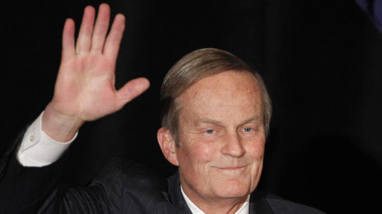 """FILE - In this Feb 18, 2012 file photo, Senate candidate Rep. Todd Akin, R-Missouri, waves to the crowd while introduced at a senate candidate forum during a Republican conference in Kansas City, Mo. Akin vowed to fight on in his embattled Senate campaign as the deadline to exit the Nov. 6 elections loomed Tuesday, Aug. 21, 2012, putting pressure on the Missouri congressman to abandon the race over his comments that women's bodies can prevent pregnancies in cases of """"legitimate rape.""""(AP Photo/Orlin Wagner, File)"""