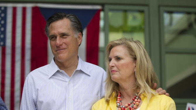 Republican presidential candidate, former Massachusetts Gov. Mitt Romney, left, stands with his wife Ann, during a campaign stop on Saturday, March 17, 2012 in Bayamon, Puerto Rico. People in the U.S. territory don't pay taxes and can't vote in U.S. presidential elections. But they can vote in primary nominating contests, and Republicans will hold their's in Puerto Rico on Sunday. (AP Photo/Evan Vucci)