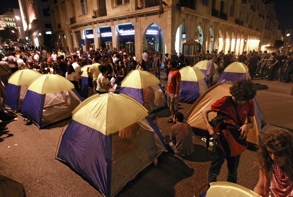 Civil society protesters set up their tent near the Parliament during a demonstration in Beirut, Lebanon, Thursday, June 20, 2013. Lebanon's parliament on May 29 extended its term by a year and a half, skipping scheduled elections because of the country's deteriorating security linked to the civil war next door in Syria. (AP Photo/Bilal Hussein)