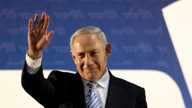 Israel's Prime Minister Benjamin Netanyahu waves to his governing Likud Party members during the Likud convention in Tel Aviv, Israel, Monday, Oct. 29, 2012. Israel's governing Likud Party has approved a merger with an ultranationalist rival, forming a hawkish bloc that appears poised to sweep upcoming parliamentary elections. The move to merge Prime Minister Benjamin Netanyahu's Likud Party with Yisrael Beitenu, which is headed by Foreign Minister Avigdor Lieberman, passed by a large majority Monday evening at a gathering of Likud activists.(AP Photo/Ariel Schalit)