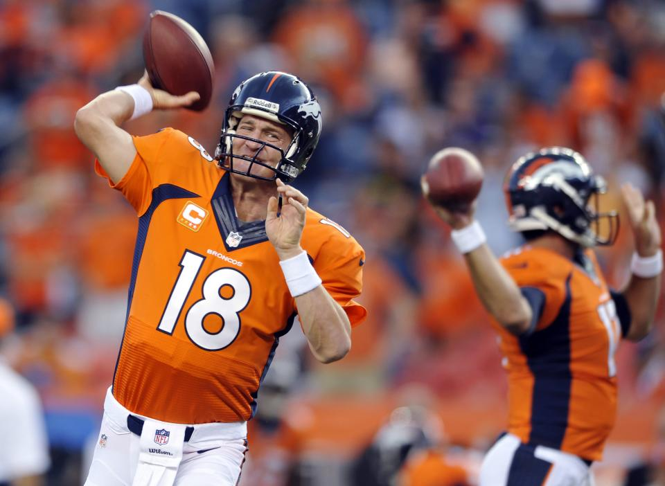 Denver Broncos quarterback Peyton Manning (18) warms up prior to the Broncos' NFL football game against the Baltimore Ravens, Thursday, Sept. 5, 2013, in Denver. (AP Photo/Jack Dempsey)