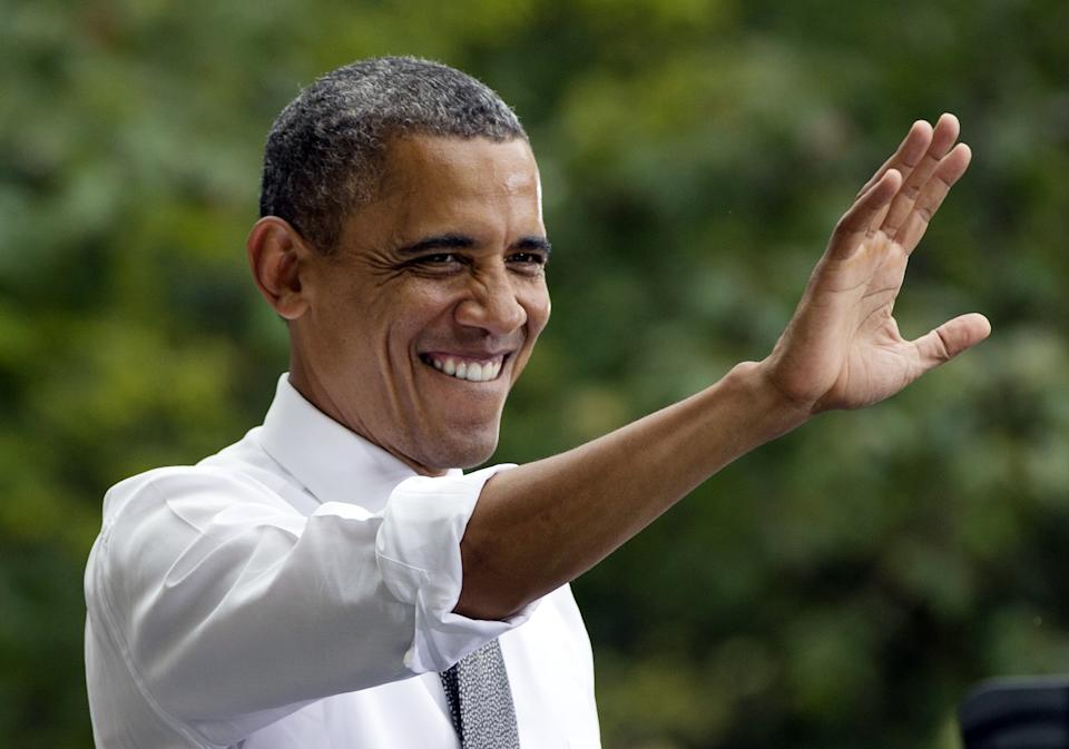 President Barack Obama waves to the crowd at a campaign event at Eden Park's Seasongood Pavilion, Monday, Sept. 17, 2012, in Cincinnati, Ohio.  (AP Photo/Carolyn Kaster)