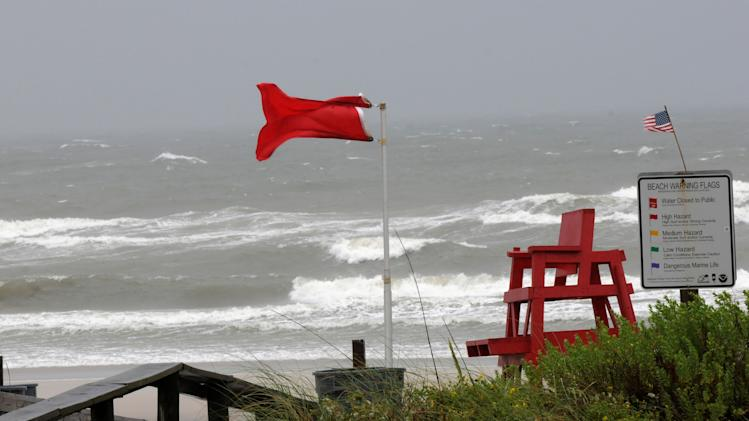 The High Hazard surf warning flag flies in front of the Atlantic Beach, Fla., Ocean Rescue station was nearly blown away by the winds.   Wind, rain and heavy surf hit the area as Tropical Storm Andrea moved into Florida.     (AP Photo/The Florida Times-Union, Bob Mack)