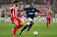 Olympiakos 3-1 Montpellier: Greek side close gap on second-placed Arsenal in Group B