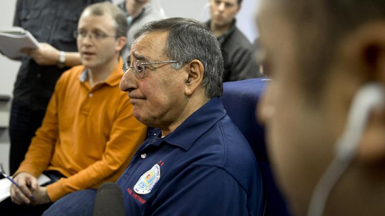 Secretary of Defense Leon Panetta speaks to the media during a briefing aboard his airplane in flight over the Pacific Ocean en route from Honolulu to Perth, Australia, Monday, Nov. 12, 2012. (AP Photo/Saul Loeb, Pool)