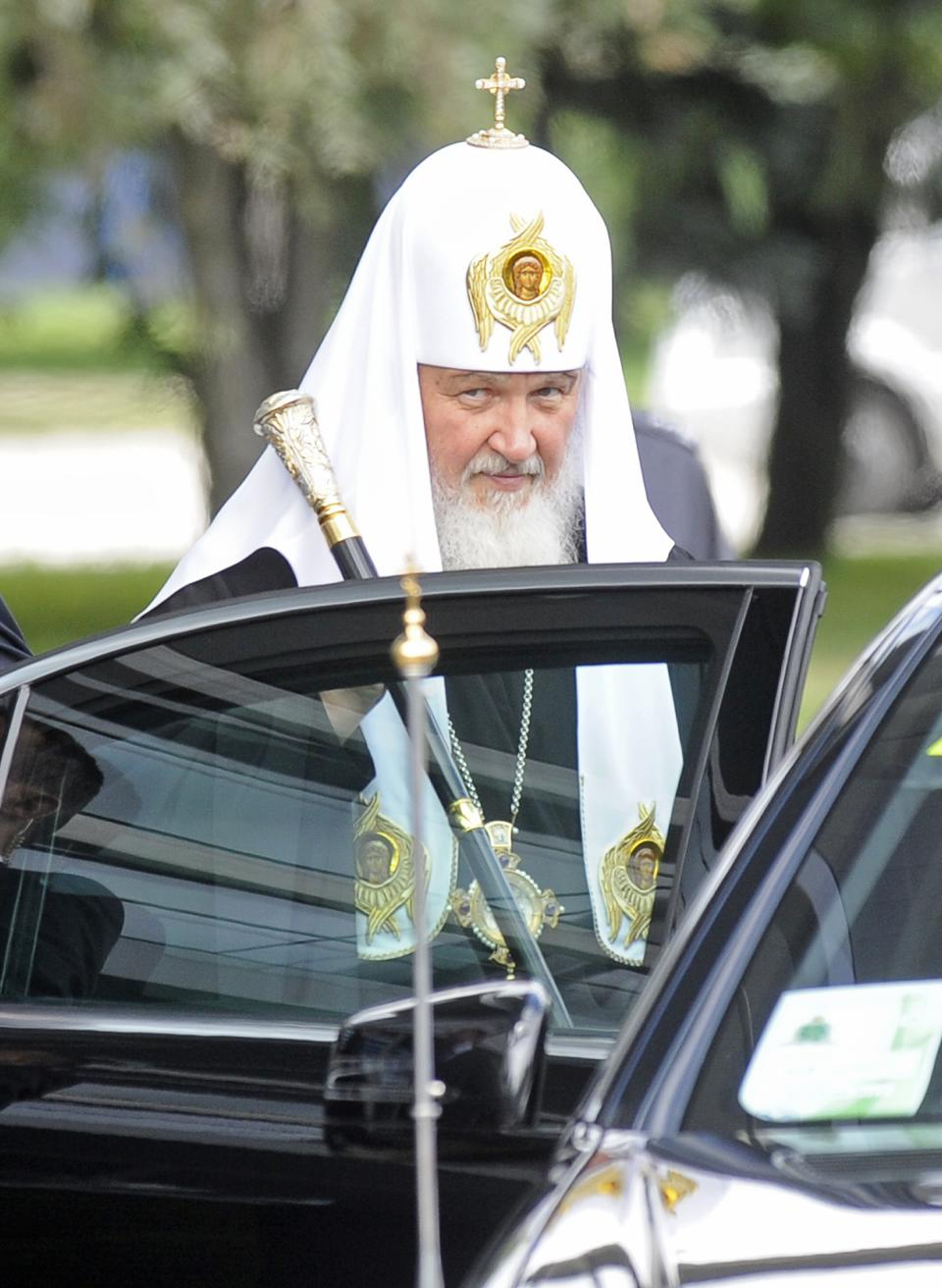 Patriarch Kirill , leader of the Russian Orthodox Church, looks at journlists as he enters his car after arrival at the Military Airport in Warsaw, Poland, Thursday, Aug. 16, 2012. Patriarch Kirill  is in Poland on a four day official visit. (AP Photo/Alik Keplicz)