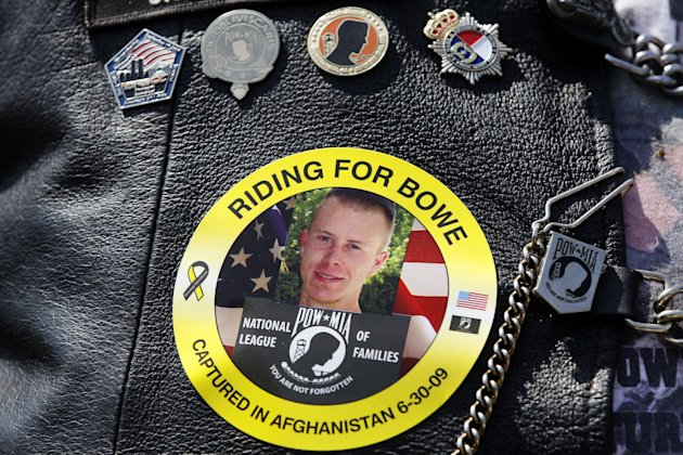 FILE -- The image of Army Sgt. Bowe Bergdahl of Hailey, Idaho, who is being held captive in Afghanistan, is worn by an audience member as Bergdahl's father Bob, not pictured, speaks at the annual Roll