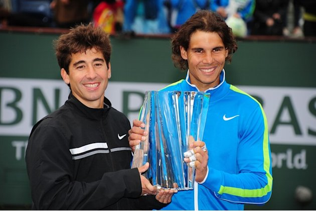 Marc Lopez (L) And Rafael Nadal Of Spain Pose With The Winner's Trophy AFP/Getty Images