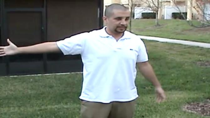In this Feb. 27, 2012 image taken from a Sanford Police video posted on a website called gzlegalcase.com by George Zimmerman's defense team, Zimmerman speaks to investigators, (not shown) at the scene of Trayvon Martin's fatal shooting a day later giving police a blow-by-blow account of his fight with the teen.  On the tape, Zimmerman did a reenactment of the scuffle with Martin in the moments before he shot the 17-year-old from Miami. (AP Photo/Sanford Police video via Zimmerman Defense Team)