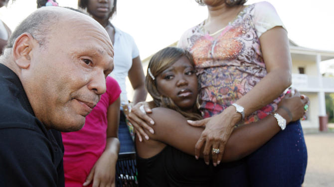Charles Wilson and his wife Te'Andrea Wilson cry during an interview at a  prayer rally in support of racial reconciliation Monday, July 30, 2012 in Crystal Springs, Miss., following the actions of some congregants at the First Baptist Church which prevented the black couple from getting married there. (AP Photo/Rogelio V. Solis)