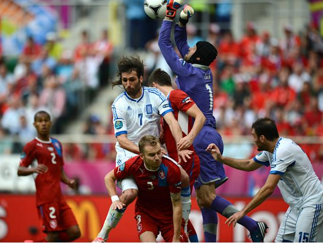 Czech Goalkeeper Petr Cech (2R) Punches The Ball Next To Greek Forward Giorgios Samaras (C) And Greek Defender Vassilis AFP/Getty Images