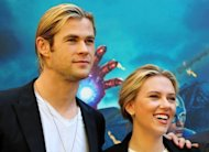 Australian actor Chris Hemsworth and US actress Scarlett Johansson pose during the photocall of &quot;The Avengers&quot; in Rome in April 2012. Earth&#39;s mightiest comic book heroes smashed North American box office records as &quot;The Avengers&quot; pummeled the competition to haul in $207.4 million on its opening weekend, final figures showed Monday