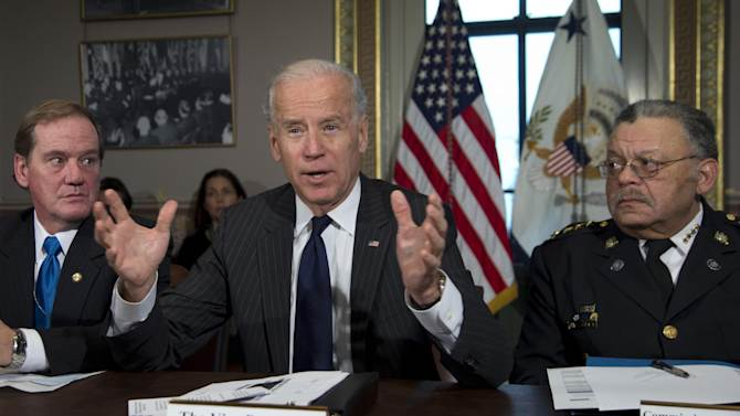 Vice President Joe Biden, flanked by the President of the National Association of Police Organizations and Boston police officer, Thomas Nee, left, and President of the Police Executive Research Forum and Major Cities Chiefs Association and Philadelphia Police Commissioner Charles Ramsey, right, speaks during a meeting at the  Eisenhower Executive Office Building in the White House complex, Thursday, Dec. 20, 2012, in Washington.  Biden is leading a task force that will look at ways of reducing gun violence.    (AP Photo/Carolyn Kaster)