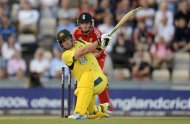 Australia's Aaron Finch (L) hits out watched by England's Jos Buttler during the first T20 international at the Rose Bowl cricket ground, Southampton August 29, 2013. REUTERS/Philip Brown