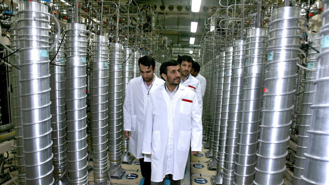 TO GO WITH STORY IRAN NUCLEAR - FILE - In this April 8, 2008 file photo released by the Iranian President's Office, Iranian President Mahmoud Ahmadinejad, front center, visits the Natanz Uranium Enrichment Facility some 200 miles (322 kilometers) south of the capital Tehran, Iran.  Technicians upgrading Iran's main uranium enrichment facility have tripled partial or full installations of high-tech machines that could be used in a nuclear weapons program to more than 600 since starting their work three months ago, according to diplomats who demanded anonymity because they said they are not authorized to disclose the information, Wednesday April 17, 2013. (AP Photo/Iranian President's Office, file)  NO SALES