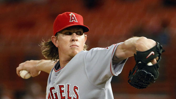 Los Angeles Angels' Jered Weaver delivers a pitch during the first inning of an interleague baseball game against the Florida Marlins, Monday, June 20, 2011 in Miami. (AP Photo/Wilfredo Lee)