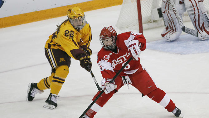 Boston forward Kayla Tutino (8) pushes the puck away from Minnesota forward Hannah Brandt (22) during the women's Frozen Four NCAA Championship college hockey game, Sunday, March 24, 2013, in Minneapolis. (AP Photo/Stacy Bengs)