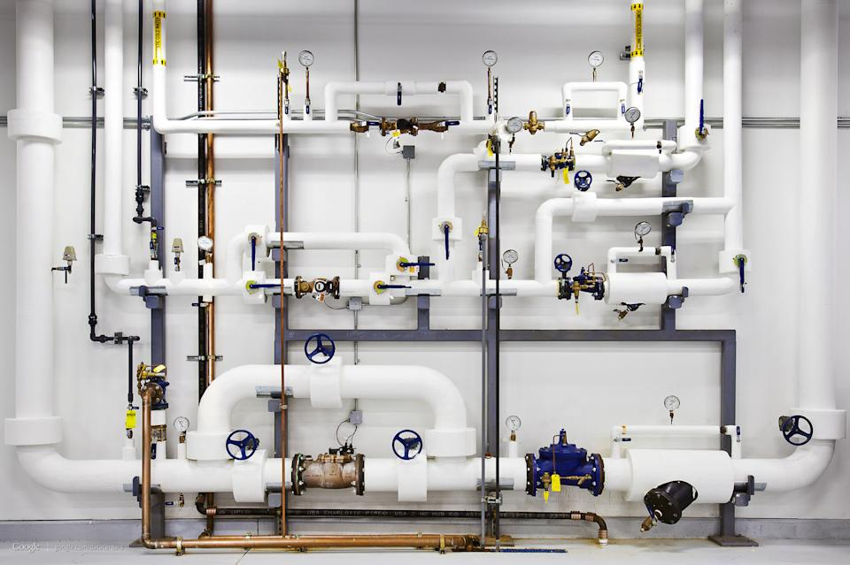 This undated photo made available by Google shows pipes with highly pressurized water at Google's data center in Douglass County, Ga. (AP Photo/Google, Connie Zhou)