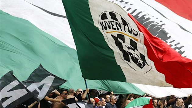 A Juventus supporter waves a giant Italian flag (Reuters)