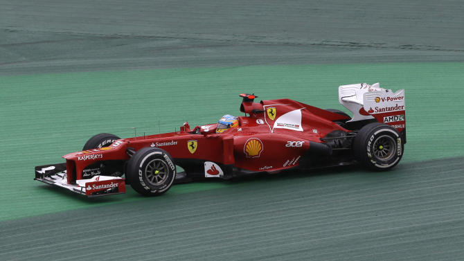 Ferrari driver Fernando Alonso of Spain goes briefly off the track during the Formula One Brazilian Grand Prix at the Interlagos race track in Sao Paulo, Brazil, Sunday, Nov. 25, 2012. (AP Photo/Ricardo Mazalan)