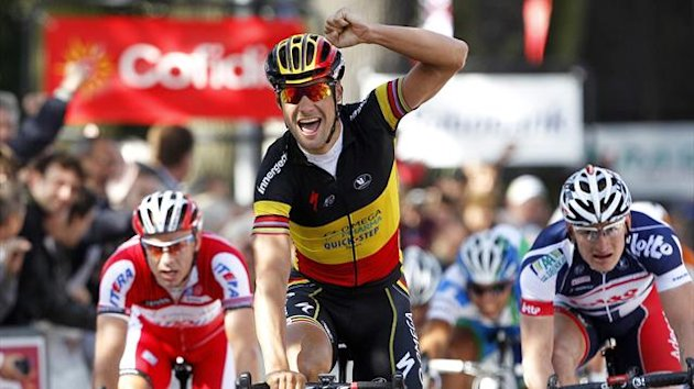 Belgian rider Tom Boonen of the Omega Pharma Quick Step team celebrates after winning the first leg of the World Ports Classic